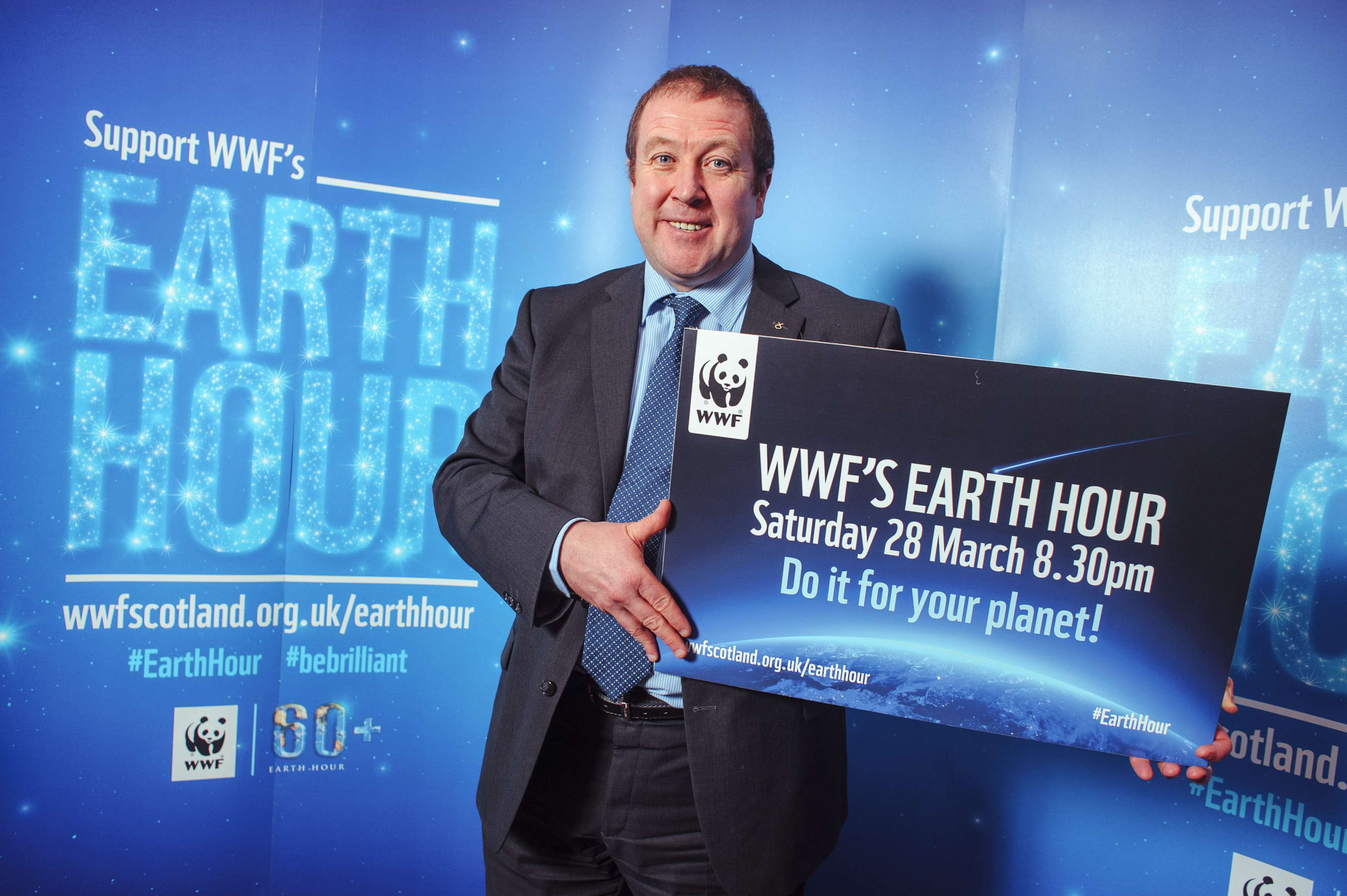 EDINBURGH, UK - March 2015: Graham Dey MSP backs WWF's Earth Hour which takes place on Saturday 23rd March at 8:30pm.  Earth Hour brings together people all across the world who will be switching out their lights for one hour to show their support for action on climate change and for a more sustainable future. (Photograph: MAVERICK PHOTO AGENCY)