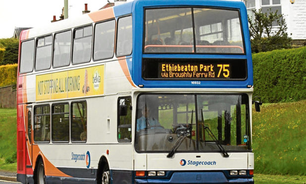 General view of a number 75 Stagecoach bus on Dundee Road heading into the centre of Dundee from Ethiebeaton Park.